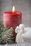 圣诞节蜡烛和光 抽象空白背景圣诞节黑暗的装饰设计模式红色的星形 免版税库存照片