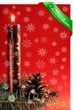 圣诞节蜡烛有红色背景和雪花 免版税库存图片