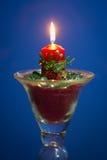 圣诞节蜡烛有蓝色背景 免版税库存图片