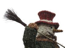 圣诞节街道与帽子和笤帚的装饰雪人 库存照片