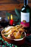 圣诞节被烘烤的鹌鹑用蘑菇 免版税库存图片