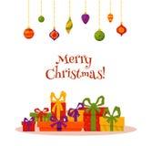 圣诞节装饰和礼物盒在五颜六色的动画片平的样式 免版税库存图片