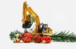 圣诞节装饰品和挖掘机模型 库存照片