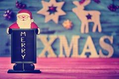 圣诞节装饰品和文本快活的xmas 库存照片