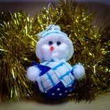 圣诞节装饰品,被充塞的雪人,与吵闹声的驯鹿 免版税图库摄影