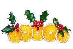 圣诞节装饰干霍莉桔子 免版税库存照片