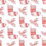 圣诞节装饰标志的传染媒介无缝的样式-袜子和霍莉 红色长袜和霍莉圣诞节装饰纹理  库存图片