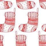 圣诞节装饰标志的传染媒介无缝的样式-袜子 圣诞节装饰纹理库存在白色背景 库存照片