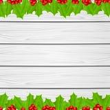 圣诞节装饰用在木背景的霍莉莓果 库存图片