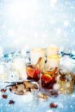 圣诞节装饰用被仔细考虑的酒和雪 免版税库存照片