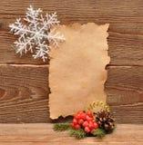 圣诞节装饰老纸张 免版税库存照片
