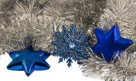 圣诞节装饰蓝星和雪花 免版税库存照片