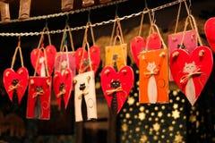 圣诞节装饰被绘的猫 免版税库存图片