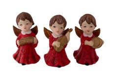 圣诞节装饰装饰新家庭想法 三个美好的老圣诞节天使做了 免版税库存照片