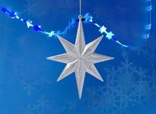 圣诞节装饰银星形 免版税库存图片