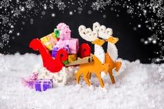 圣诞节装饰驯鹿和圣诞老人的美好的构成 免版税图库摄影