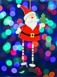 圣诞节装饰,五颜六色的bokeh背景的圣诞老人 免版税库存照片