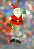 圣诞节装饰,五颜六色的bokeh背景的圣诞老人 库存照片