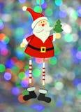 圣诞节装饰,五颜六色的bokeh背景的圣诞老人 免版税库存图片