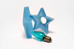 圣诞节诗歌选的星号 有一个电灯泡的手电l的 免版税库存图片