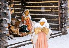 圣诞节诞生场面,与羊羔的天使在雪 免版税图库摄影
