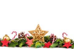 圣诞节边界-与树的大在白色隔绝的星和装饰 库存图片
