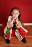 圣诞节逗人喜爱的女孩一点穿戴 免版税图库摄影