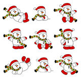 圣诞节逗人喜爱的集雪人 免版税库存图片