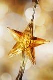 圣诞节金黄星形 库存图片