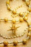 圣诞节金黄装饰品星形 免版税图库摄影