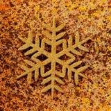 圣诞节金黄雪花符号 库存照片