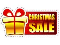 圣诞节销售和礼物盒在红色横幅与雪花 免版税图库摄影