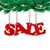 圣诞节销售标记和圣诞树 免版税库存照片