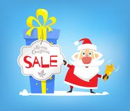 圣诞节销售,折扣 圣诞老人和大箱礼物 库存图片
