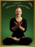 圣诞节问候瑜伽 图库摄影