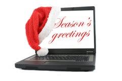 圣诞节问候膝上型计算机 免版税库存图片