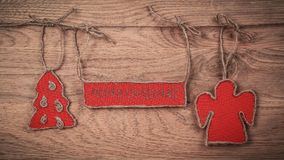 圣诞节问候附有在木背景的一条绳索 库存图片