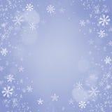 圣诞节雪花背景。假日蓝色卡片 免版税库存照片