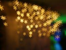 圣诞节雪花bokeh背景 免版税库存图片