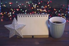 圣诞节静物画用咖啡、玩具和笔记本 免版税库存图片
