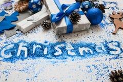 圣诞节题字 装饰和礼物背景 免版税库存图片