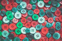 圣诞节颜色缝合的按钮 定调子 葡萄酒 库存图片
