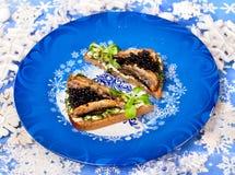 圣诞节食物白鲸鱼子酱 免版税库存照片