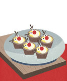 圣诞节驯鹿杯形蛋糕 免版税库存照片