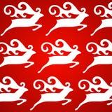 圣诞节鹿红色背景 库存图片