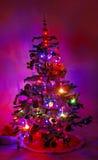 圣诞节黑暗的发光的结构树 库存图片