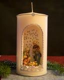 圣诞节,与圣诞节小儿床形象的蜡烛 免版税库存图片