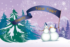 圣诞节,二snowmans在森林里 免版税库存图片