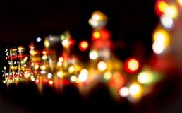圣诞节,庆祝概念:在黑暗的背景的被弄脏的五颜六色的光 库存照片