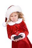 圣诞节:女孩从坏行为的圣诞老人得到煤炭 免版税库存图片